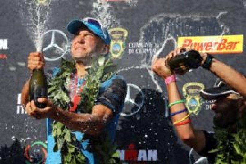 Il battesimo vincente, sotto una cascata di champagne, di Andreas Dreitz, al suo primo full distance proprio nell'Ironman Italy Emilia Romagna (Foto ©Bryn Lennon/Getty Images for IRONMAN)