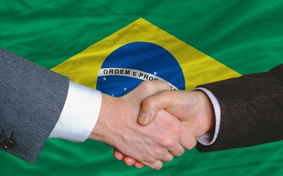 Business etiquette in brazil monetary librarymonetary library businessmen handshake after good deal in front of brazil flag m4hsunfo