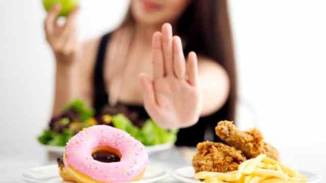 Woman Saying No To Fast Food Fried Diet