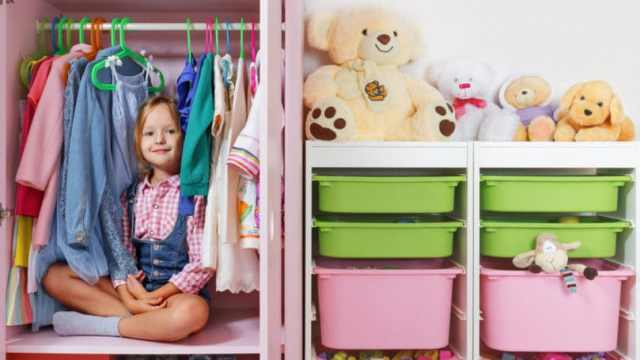 Little Girl Sitting In Wardrobe Closet Clean Organized