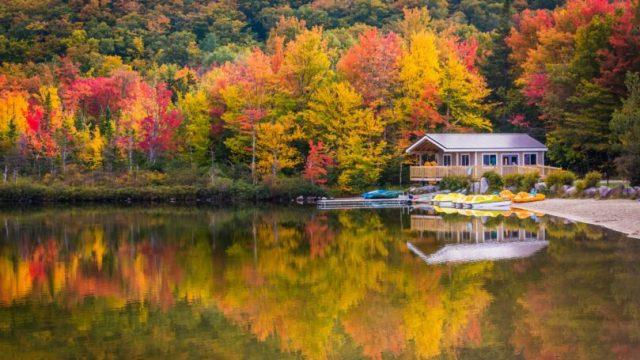 New Hampshire Boathouse Fall Colors Reflecting Echo Lake