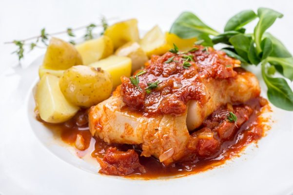 White fish with tomato anchovy sauce