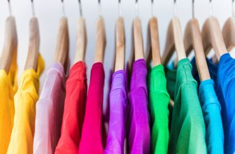 Rainbow coloured clothes on hangers