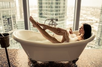 Woman relaxing in luxury bathtub