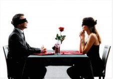 Two people at a romantic dinner with blindfolds on