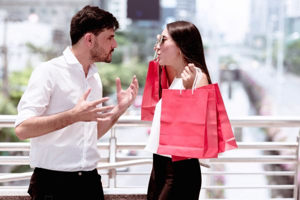 Couple arguing about one of them shopping too much