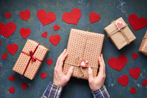 Man wrapping valentines gifts