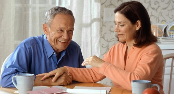 Woman and older man laughing together