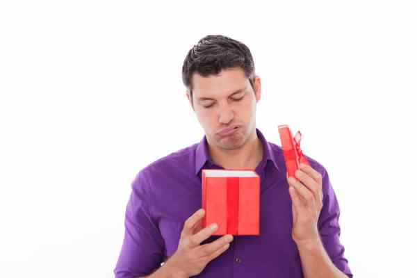 Man looking disappointed with gift