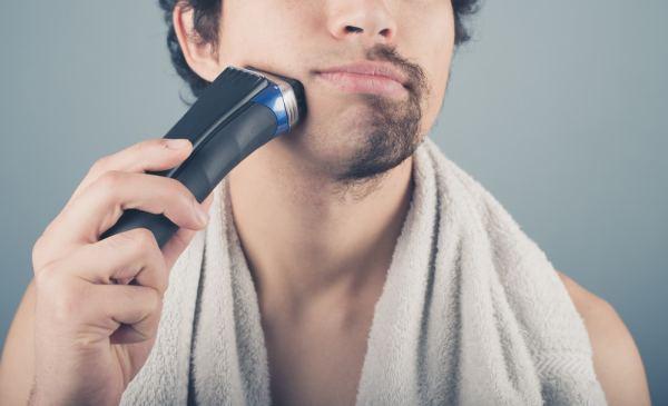 Man shaving off his beard