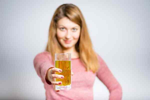 Woman offering a beer