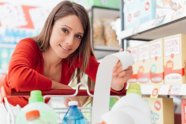Woman looking at her supermarket receipt