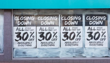 Shop with closing down posters in the windows
