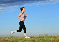 Young woman running outdoor.