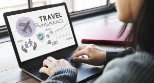 Laptop with a travel insurance site on the screen