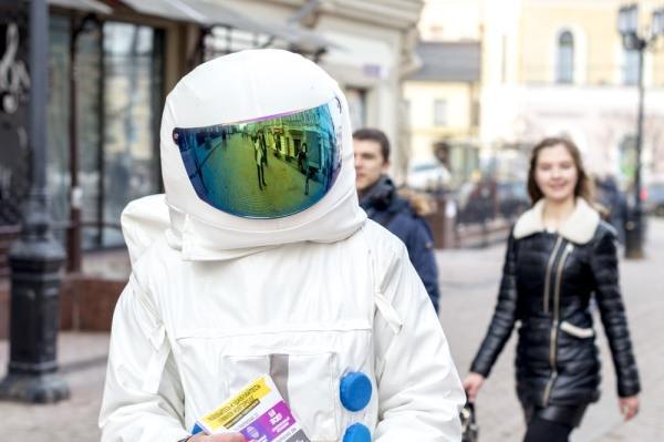 Leafletter in astronaught suit