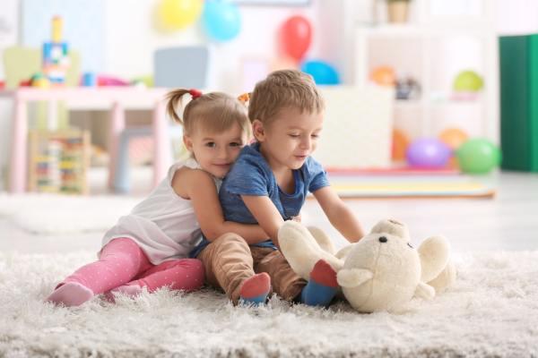 Cute little children cuddling