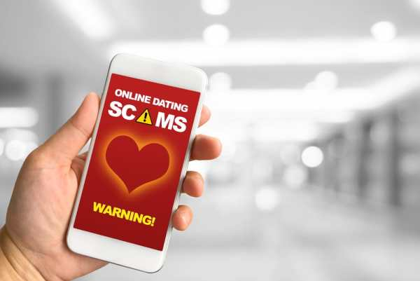 Online dating scam warning on phone