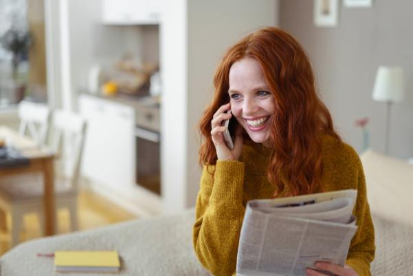 Redhead woman laughing on the phone