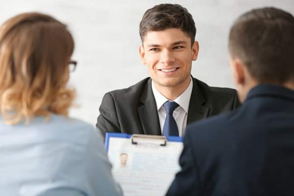 Young male professional smiling at job interview