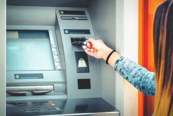 Woman using ATM cash machine