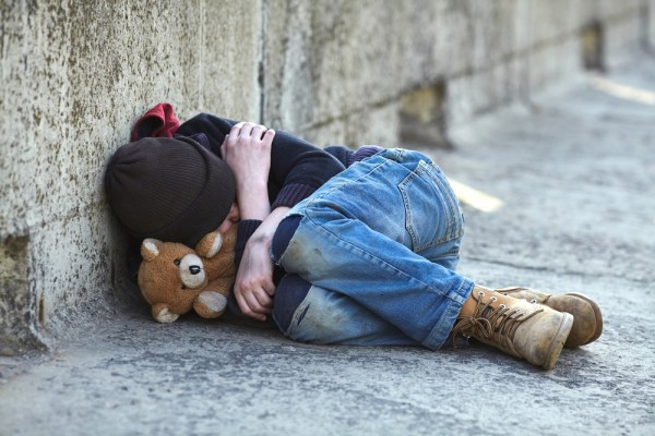 homeless child sleeping on the street