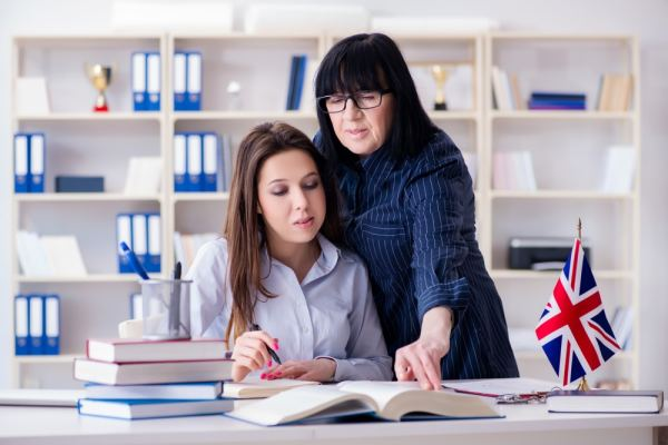 Woman teaching English to a foreign student