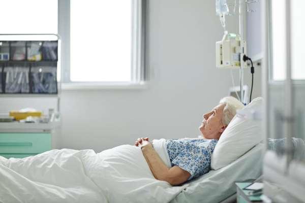 Elderly woman in a hospital bed