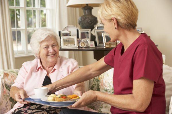 Senior woman with a home care nurse