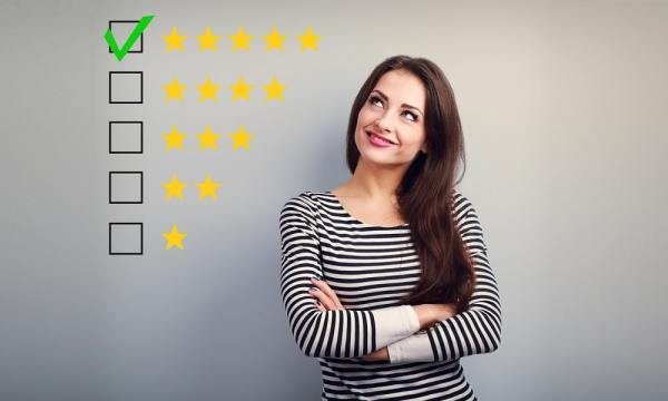 Woman beside a star rating system graphic