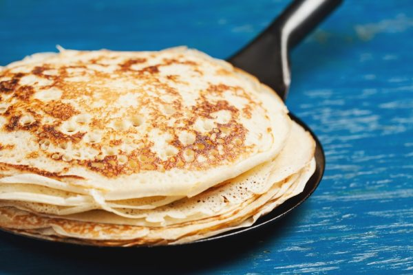 Stack of crepe pancakes in frying pan