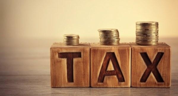 Tax spelled with alphabet blocks
