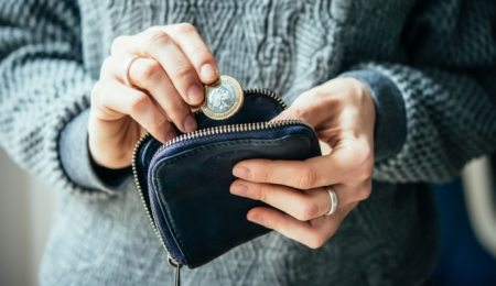 Woman putting coin in purse