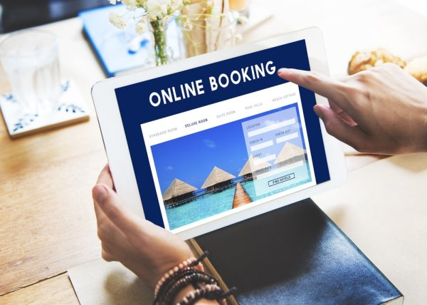 Booking holiday online on a tablet