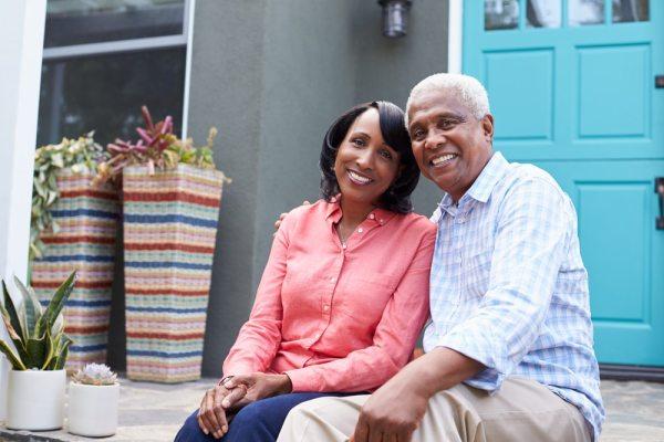 Older couple in front of their home/Front Door
