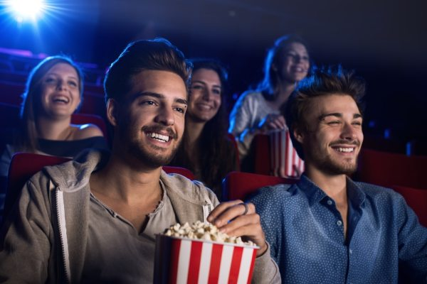 Young adults at the cinema