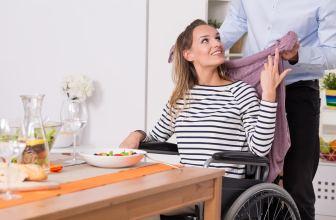 Happy disabled woman having breakfast