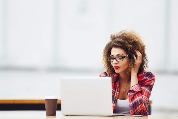 Woman using laptop to research online