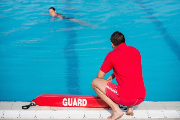 Lifeguard by a swimming pool