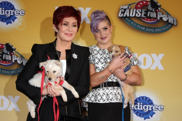 Sharon and Kelly Osbourne with their pet dogs