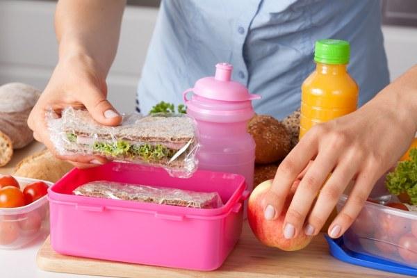 Woman preparing lunch box
