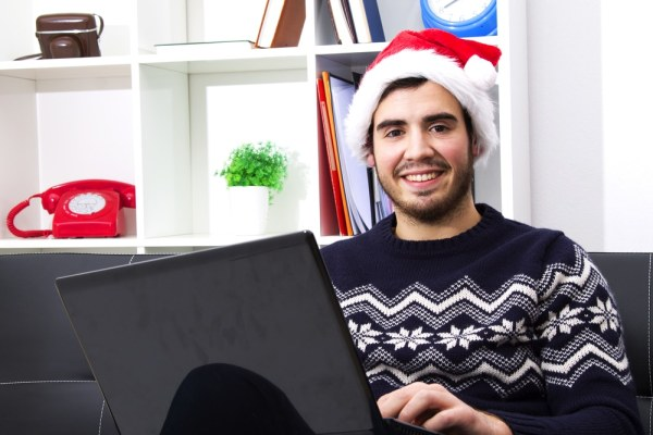 Festive man using laptop