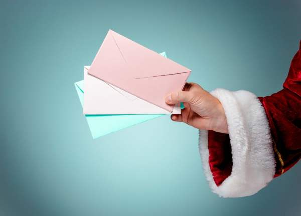 Santa's hand holding letters