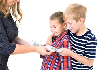 Mother giving brother and sister pocket money