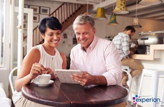 Experian_Simple savings to clear your clutter - couple in coffee shop