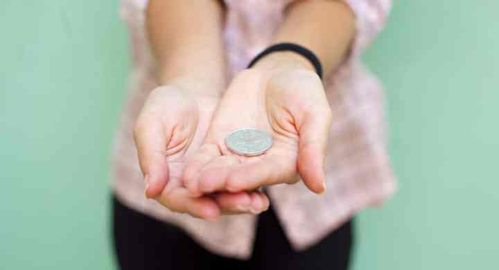 Woman holding out a coin
