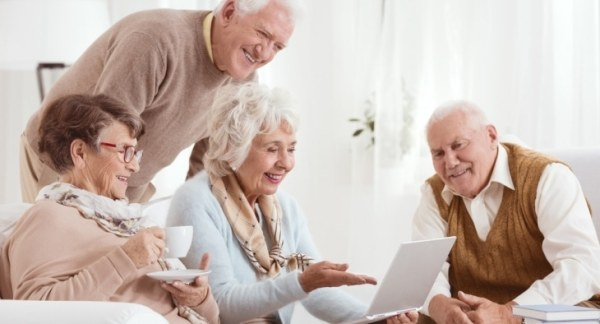 Group of pensioners looking at a laptop