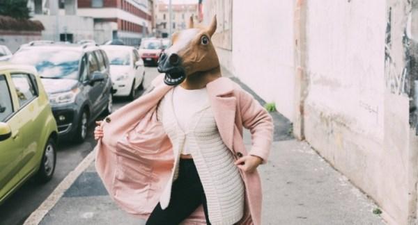 Weird woman wearing horse head mask