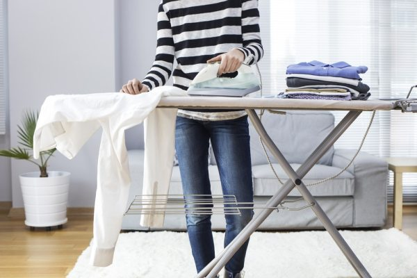 woman ironing in the living room/lounge