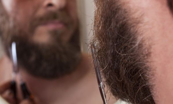 Man trimming his beard